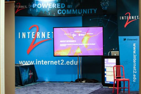 Photo of the colorful, mostly blue Internet2 booth at the Internet2 Community Showcase